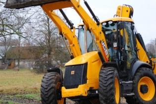 Roheline Traktor. Ekskavaator-laadusteenused.